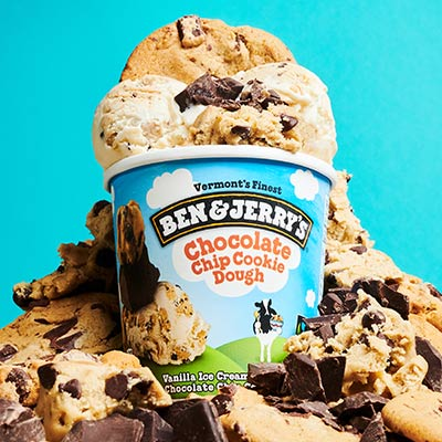 Pint of Ben & Jerry's Chocolate Chip Cookie Dough ice cream surrounded by bits of cookie dough